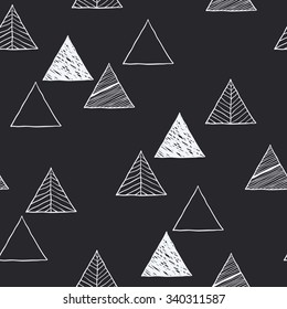 Seamless hand-drawn triangles pattern. Abstract Hand drawn background for design and decoration textile, covers, package, wrapping paper.