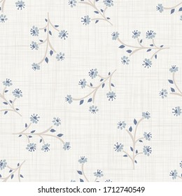 Seamless herb floral pattern in french blue linen shabby chic style. Hand drawn country bloom texture. Rustic woven background. Kitchen towel home decor swatch. Simple flower motif all over print
