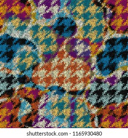 Seamless Hounds-tooth pattern. Imitation of a texture of rough canvas. Vector image.
