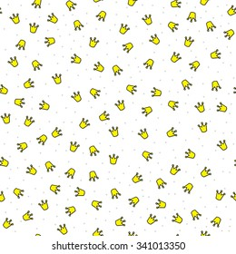Seamless illustrated pattern made of little yellow crowns and grey circles on white background
