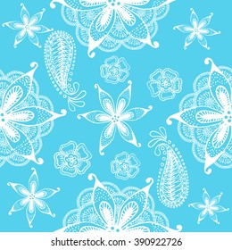 Seamless indian pattern on a turquoise background. Hand drawn doodles. Vector.