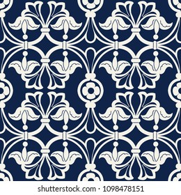 Seamless indigo dye floral ethnic block printed pattern. Vector ornament, traditional Russian motif with lily flowers and ogee moulding, ecru on navy blue background. Textile, wallpaper print.