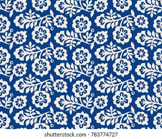 Seamless indigo woodblock printed floral pattern. Vector ethnic ornament, traditional Russian motif with blossoms, ecru on navy blue background. Textile print.
