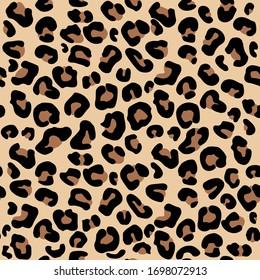 Seamless leopard pattern on beige background. Vector illustration.