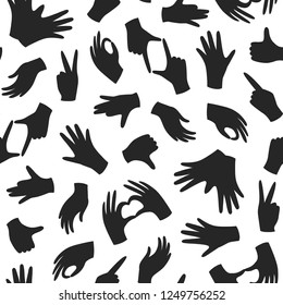 Seamless monochrome pattern with hand gesture. Human hand, palm black silhouette. Vector repeating design for fabric, wallpaper or wrap paper.
