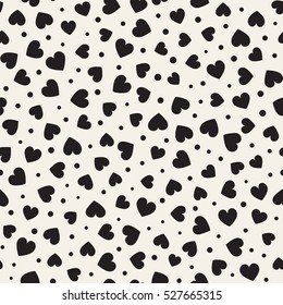 Seamless monochrome pattern with hearts and dots. Vector repeating texture. Perfect for printing on fabric or paper.