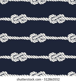 Seamless nautical rope pattern. Endless navy illustration with white loop ornament. Marine figure eight knots on dark blue backdrop. Trendy maritime style background. For fabric, wallpaper, wrapping