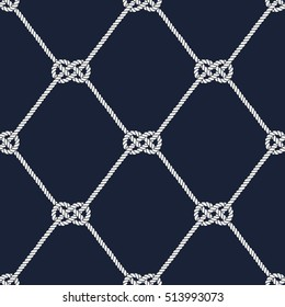 Seamless nautical rope pattern. Endless navy illustration with white loop ornament. Marine Carrick Bend knots on dark blue backdrop. Trendy maritime style background. For fabric, wallpaper, wrapping