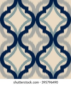 Seamless ogee ikat pattern, vector ethnic background, traditional eastern motif in calm blue and gray tones.