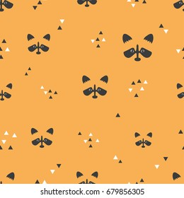 Seamless orange pattern with rac?oon faces and triangles. Vector background.