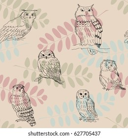Seamless ornament with wild owls on a branches background