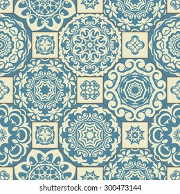 Seamless patchwork pattern from blue and beige Moroccan tiles, ornaments. Can be used for wallpaper, pattern fills, surface textures, textile, cover etc.