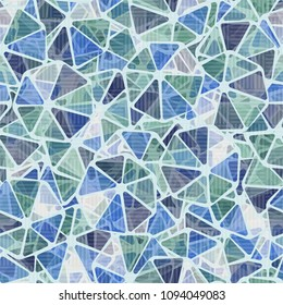 Seamless pattern. Abstract texture. Rounded heptagons divided into sectors. Color hodgepodge. Covered with a translucent mesh.