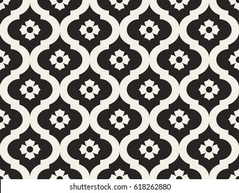 Seamless pattern with abstract white branches and flowers on black background.  Decorative lattice in the Moroccan style. Vector monochrome ethnic design.
