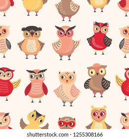 Seamless pattern with adorable owls on white background. Backdrop with cartoon forest birds or cute funny owlets. Colorful flat vector illustration for wrapping paper, fabric print, wallpaper.