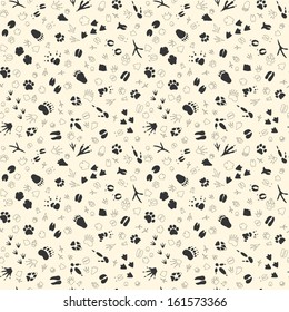 Seamless pattern with animal tracks