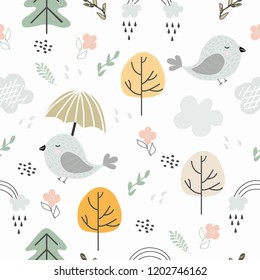 Seamless pattern autumn forest with birds, Christmas trees, trees, flowers, rainbow, rain and clouds. Vector illustration for printing on t-shirts, Wallpaper, packaging, bed linen, textiles, banner
