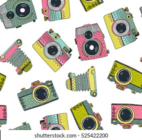 Seamless pattern background with hand drawn ornamental retro cameras. Vector illustration.