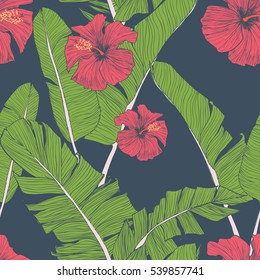 Seamless pattern with banana leaves, tropical flowers and geometrical  elements