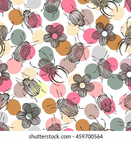 Seamless pattern with beetles and flowers on a polka dot background.