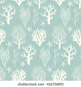 Seamless pattern with beige corals and starfishes on a blue background