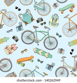 Seamless pattern with bicycles, boards and accessories