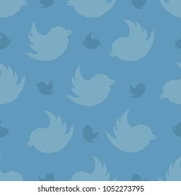 Seamless pattern from birds on a pastel blue background. The Bullfinch Pattern