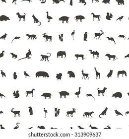 Seamless pattern with Black Animals and Birds Silhouettes. Hand drawn vector illustration.
