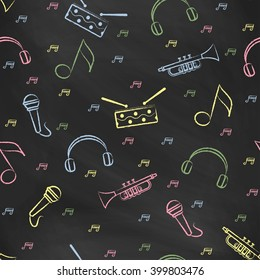 Seamless pattern black chalk board with color children's chalk drawings. Hand-drawn style. Seamless vector wallpaper with the image of  drum, microphone, pipe, headphones and note