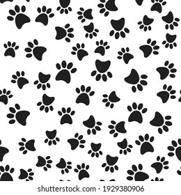 Seamless pattern with black dog paws print on white background. Vector flat cartoon illustration.