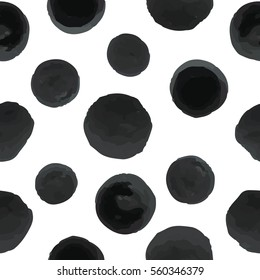 Seamless pattern of black dots on a white background. Vector.