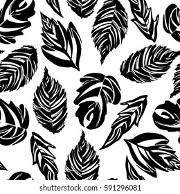 Seamless pattern with black leaves silhouettes.
