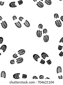 Seamless pattern of black silhouettes of prints of shoes