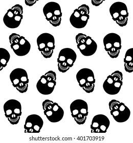 seamless pattern black skulls on a white background.