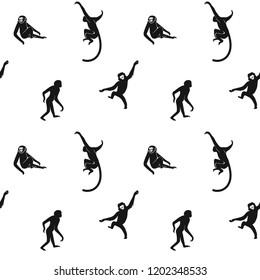 Seamless pattern of black small primate silhouettes on a white background. Vector Design element.