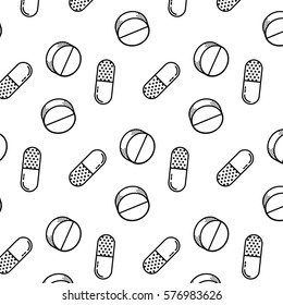 Seamless pattern of black and white medical pills. Background made from dotted pills and capsules.