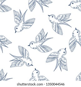 Seamless pattern with blue swallows on white background. Vector illustration.