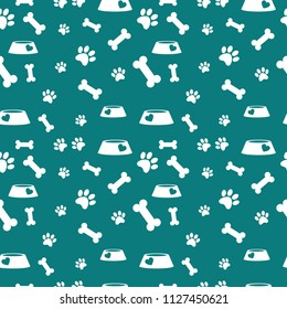 Seamless pattern with bones and feed powl and paws