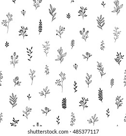 Seamless pattern of branches and herbs.