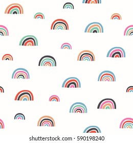 Seamless pattern with bright color rainbows
