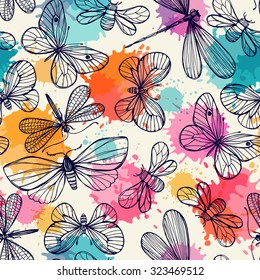 Seamless pattern with butterflies and dragonflies. Freehand drawing