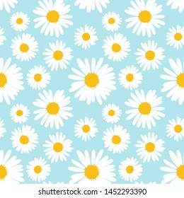 Seamless pattern with chamomile flowers on blue background.