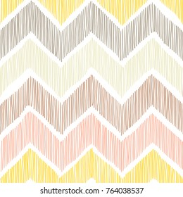 Seamless pattern. Chevron, a zigzag ornament. White, yellow, pink and gray colors. Pritn for textiles in doodle style. Vector illustration.
