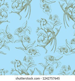 Seamless pattern in chinoiserie style with birds, peonies, branch and leaves. Vector hand drawing illustration. Blue background.