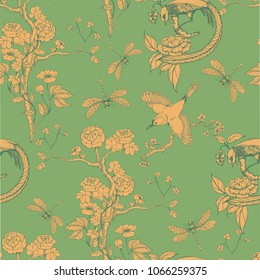 Seamless pattern in the chinoiserie style with orange peonies, dragonfly and bird on green background for wedding, scrapbooking, wallpaper and other design.