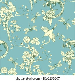 Seamless pattern in the chinoiserie style with peonies, dragonfly and bird on blue background for wedding, scrapbooking, wallpaper and other design.