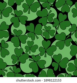 Seamless pattern of clover leaves and light green circles of various sizes on a black background, a symbol of good luck and St. Patrick's day illustration