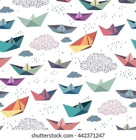 Seamless pattern with color paper ships and clouds
