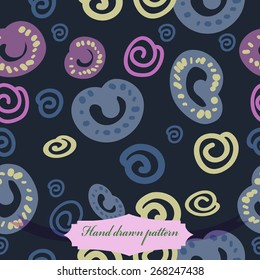 Seamless pattern of colored doodles, spirals, spots, label. Hand drawn.