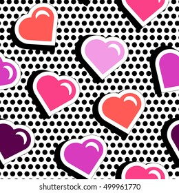 Seamless pattern with colorful badge shape hearts on black dotty background. Vector illustration with heart stickers in cartoon 80s-90s comic style. Pop art style repeating texture with red hearts.
